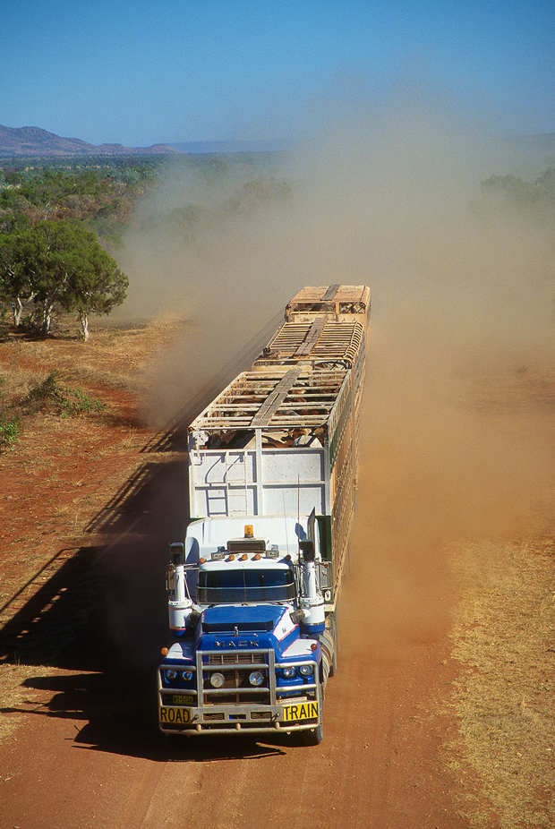 road train and cloud of dust behind it