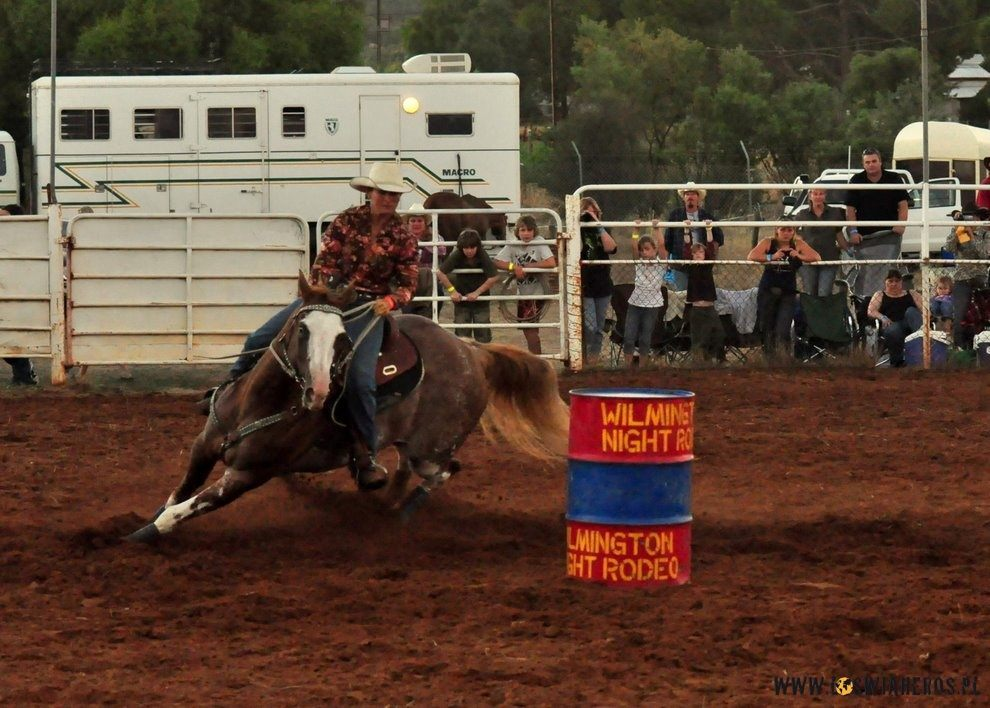 Barrel racing during rodeo.